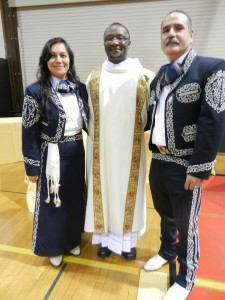 Alicia and Marcos Diaz, prayerful friends of seminarians, with Rev. Mr. Clive Otieno.