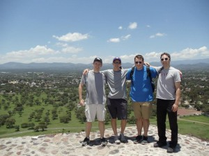 "Semiarians Tom Logue, James Guarascio, Michael Groth & Luke Zanoni on top of a pyramid in Mexico during a ""time-out"" from Spanish studies."